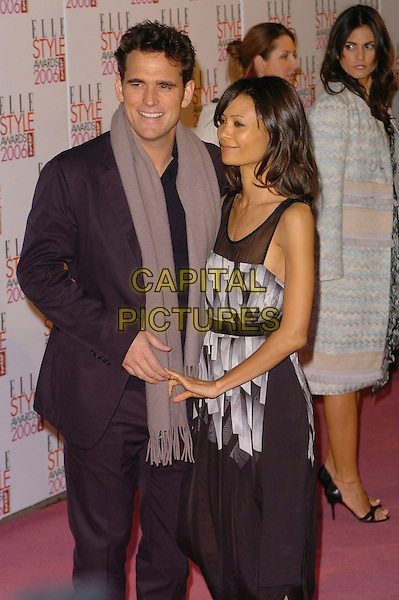 MATT DILLON & THANDIE NEWTON.Elle Style Awards 2006 - Arrivals,.Atlantis Gallery, Old truman Brewery, Brick Lane, London, England,.February 20th 2006..half length grey scarf black printed dress holding hands fingers.Ref: CAN.www.capitalpictures.com.sales@capitalpictures.com.©Capital Pictures