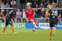Andrew Boyce of Grimsby Town (centre) clear the ball during the Sky Bet League 2 match between Barnet and Grimsby Town at The Hive, London, England on 29 April 2017. Photo by David Horn.