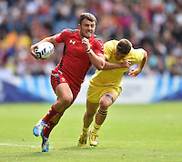 Wales's Luke Morgan gets away from Australia's Greg Jeloudev<br /> <br /> Australia Vs Wales - Men's quarter-final<br /> <br /> Photographer Chris Vaughan/CameraSport<br /> <br /> 20th Commonwealth Games - Day 4 - Sunday 27th July 2014 - Rugby Sevens - Ibrox Stadium - Glasgow - UK<br /> <br /> © CameraSport - 43 Linden Ave. Countesthorpe. Leicester. England. LE8 5PG - Tel: +44 (0) 116 277 4147 - admin@camerasport.com - www.camerasport.com