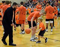Westside Eagle Observer/MIKE ECKELS<br /> <br /> Jeff Melton (left0, Gravette Assistant Coach, helps one of his players coach a future Lions basketball star during the 2020 Orange Out Day event at the Competition Gym Jan. 7. More than 30 future Lions basketball players showed off some of the drills they learned during an earlier basketball camp in Gravette.