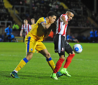 Lincoln City's Nathan Arnold vies for possession with Chester's Theo Vassell<br /> <br /> Photographer Andrew Vaughan/CameraSport<br /> <br /> Vanarama National League - Lincoln City v Chester - Tuesday 11th April 2017 - Sincil Bank - Lincoln<br /> <br /> World Copyright &copy; 2017 CameraSport. All rights reserved. 43 Linden Ave. Countesthorpe. Leicester. England. LE8 5PG - Tel: +44 (0) 116 277 4147 - admin@camerasport.com - www.camerasport.com