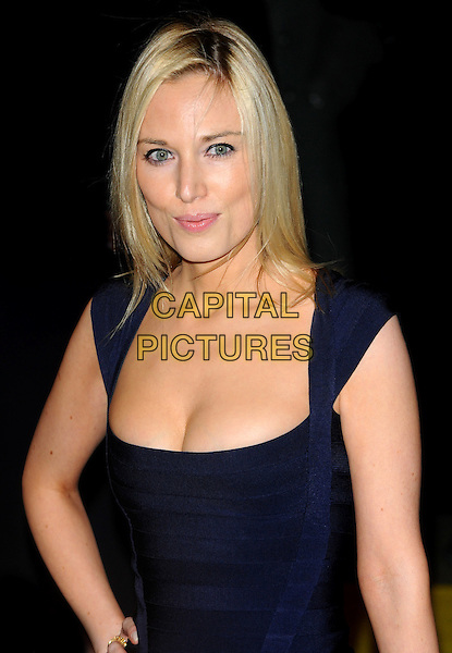 "IMOGEN LLOYD WEBBER .Attending the Press Night for the new musical stage production of the ""Wizard of Oz"", London Palladium, London, .England, UK, March 1st, 2011..half length navy blue dress cleavage hand on hip cheekbones beauty make-up .CAP/CJ.©Chris Joseph/Capital Pictures."