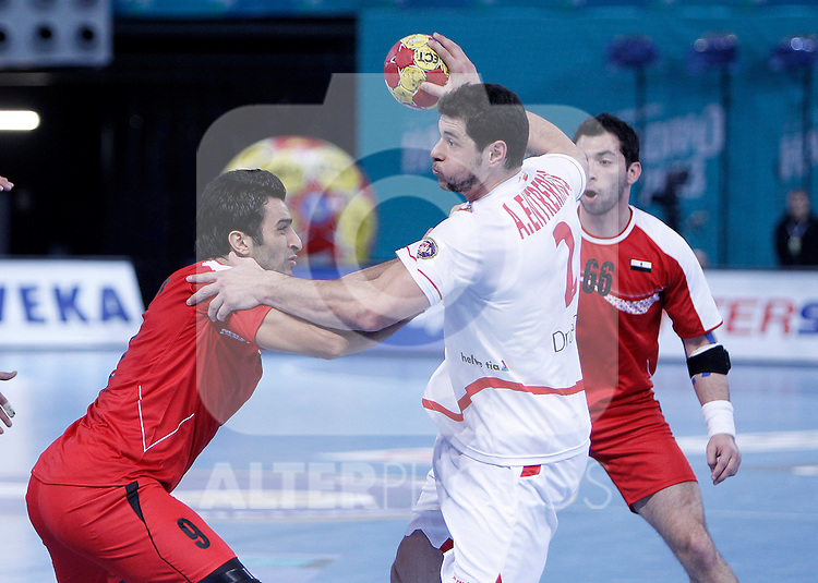 Egypt's Islam Hassan (l) and Ahmed Mostafa (r) and Spain's Alberto Entrerrios during 23rd Men's Handball World Championship preliminary round match.January 14,2013. (ALTERPHOTOS/Acero)