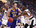 SIOUX FALLS, SD: MARCH 7: Tra-Deon Hollins #24 of Omaha reaches on Mike Daum #24 of South Dakota State during the Men's Summit League Basketball Championship Game on March 7, 2017 at the Denny Sanford Premier Center in Sioux Falls, SD. (Photo by Dick Carlson/Inertia)
