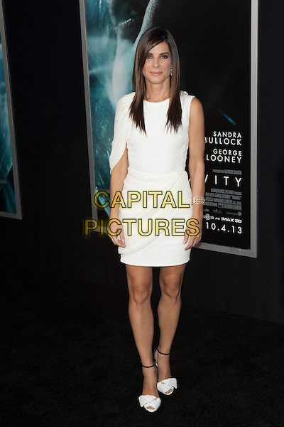 Sandra Bullock<br /> The 'Gravity' premiere at AMC Lincoln Square Theater, New York City, NY., USA.<br /> October 1st, 2013<br /> full length white dress cape draped <br /> CAP/MPI/COR<br /> &copy;Corredor99/ MediaPunch/Capital Pictures