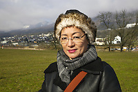 Switzerland. Canton Solothurn. Olten. Dolma Knell enjoys walking outside near her home. The swiss tibetan woman is an Aeschimann's child who arrived 50 years ago in Switzerland to receive custody on a private initiative by an influential Swiss industrialist, Charles Aeschimann. In 1962, Charles Aeschimann agreed with the Dalai Lama to take 200 children and place them in Swiss foster homes and give them a chance for a better life and a good education. Most of the children still had parents in exile or in Tibet, just a few were orphans. 25.02.2015 © 2015 Didier Ruef