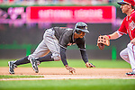 22 September 2013: Miami Marlins outfielder Juan Pierre dives safely back to first during game action against the Washington Nationals at Nationals Park in Washington, DC. The Marlins defeated the Nationals 4-2 in the first game of their day/night double-header. Mandatory Credit: Ed Wolfstein Photo *** RAW (NEF) Image File Available ***
