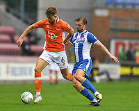 Blackpool's Will Aimson battles with Wigan Athletic's Alex Gilbey<br /> <br /> Photographer Dave Howarth/CameraSport<br /> <br /> The Carabao Cup - Wigan Athletic v Blackpool - Tuesday 8th August 2017 - DW Stadium - Wigan<br />  <br /> World Copyright &copy; 2017 CameraSport. All rights reserved. 43 Linden Ave. Countesthorpe. Leicester. England. LE8 5PG - Tel: +44 (0) 116 277 4147 - admin@camerasport.com - www.camerasport.com