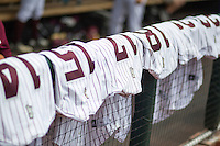 Mississippi State Bulldog uniforms are lined up before Game 11 of the 2013 Men's College World Series against the Oregon State Beavers on June 21, 2013 at TD Ameritrade Park in Omaha, Nebraska. (Andrew Woolley/Four Seam Images)
