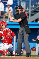 Umpire Clayton Hamm makes a call during a NY-Penn League game between the Batavia Muckdogs and Auburn Doubledays at Dwyer Stadium on September 2, 2012 in Batavia, New York.  Batavia defeated Auburn 8-7.  (Mike Janes/Four Seam Images)