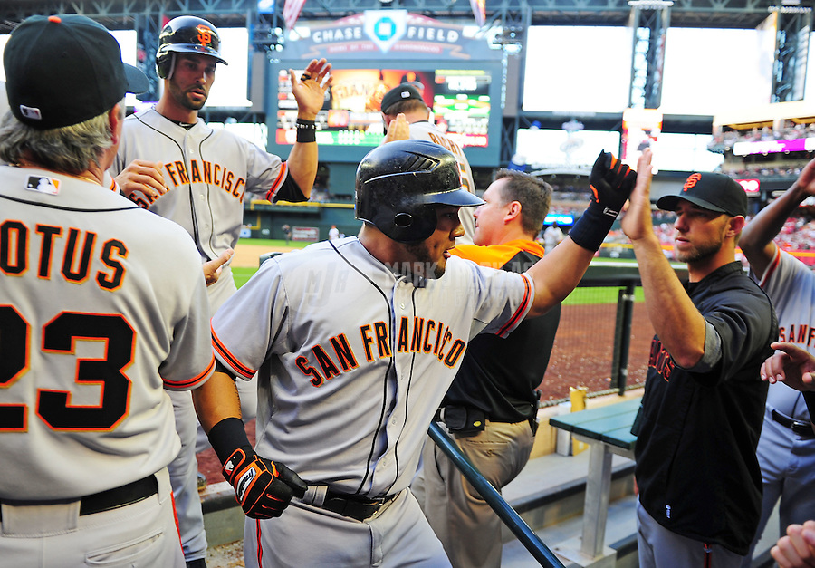 Apr. 6, 2012; Phoenix, AZ, USA; San Francisco Giants batter Melky Cabrera is congratulated by teammates after hitting a two run home run in the third inning against the Arizona Diamondbacks during opening day at Chase Field.  Mandatory Credit: Mark J. Rebilas-