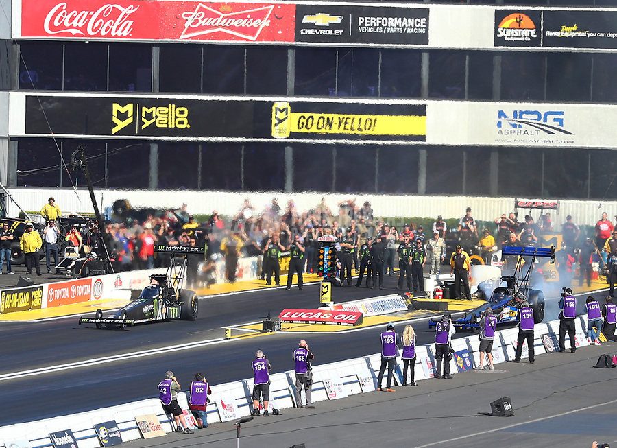 Feb 11, 2018; Pomona, CA, USA; NHRA top fuel driver Brittany Force (left) prior to crashing during round one of the Winternationals at Auto Club Raceway. Mandatory Credit: Mark J. Rebilas-USA TODAY Sports