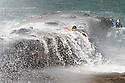 15/08/12  After battling against giant waves three boys are washed off the old quay wall at Hartland, North Devon...All Rights Reserved - F Stop Press.  www.fstoppress.com. Tel: +44 (0)1335 300098.Copyrighted Image. Fees charged will reflect previously agreed terms or space rates for individual publications, states or country.
