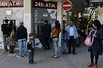 Cypriots stand in line to withdraw money from the ATM in Nicosia, Cyprus on March 24, 2013.  As the IMF, the EU and Cyprus hammer out a deal in Brussels to save the Cypriot banking sector, known for its abundance of offshore accounts, many in Cyprus have withdrawn as much as they can from their accounts at ATMs and are fearful for what the coming week might hold.