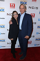 """STUDIO CITY, CA - NOVEMBER 6: (L-R) Laura San Giacomo and Mark Harmon attend the TV Guide Magazine Cover Party for Mark Harmon and 15 seasons of the CBS show """"NCIS"""" at River Rock at Sportsmen's Lodge on November 6, 2017 in Studio City, California. (Photo by JC Olivera/PictureGroup)"""