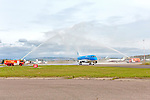 Inverness Airport welcomed KLM&rsquo;s Inaugural flight from Amsterdam. To celebrate the new route, the first flight from Schiphol, Amsterdam was greeted by a water cannon salute upon arrival.  On board were Barry ter Voert, Senior Vice President, Air France KLM European Markets and Wilco Swejen, Director for Aviation Marketing, Schipol Airport.  Provost Helen Carmichael, The Highland Council, Inglis Lyon, Managing Director of Highlands and Islands Aiports and Drew Hendry MP (Inverness, Nairn, Badenoch and Strathspey) met the delegation, officially welcoming the group to the Highlands.   <br /> <br /> Pictured: KLM flight KL0929 (Embraer ERJ-175STD) arrives at Inverness Dalcross airport.<br /> <br /> Image by: Malcolm McCurrach<br /> Tue, 17, May, 2016 |  &copy; Malcolm McCurrach 2016 |  New Wave Images UK | Insertion and use fees apply |  All rights Reserved. picturedesk@nwimages.co.uk | www.nwimages.co.uk | 07743 719366 <br /> <br /> Event Photographer | Corporate Photographer | Editorial Photographer | Music Photographer