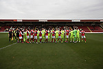 The two teams exchanging pre-match handshakes on the pitch at Aggborough, home of Kidderminster Harriers (in red) before they played visitors Gainsborough Trinity in a National League North fixture. Harriers were formed in 1886 and have played at their current home since 1890. They won this match  by 3-0 watched by a crowd of 1465.