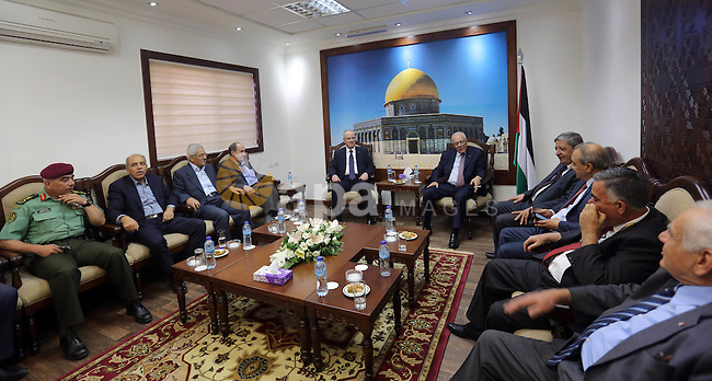 Palestinian Prime Minister Rami Hamdallah meets with Palestinian leaders on the first day of Eid al-Adha, in the West Bank city of Ramallah on September 24, 2015. Muslims across the world are celebrating the annual festival of Eid al-Adha, or the Festival of Sacrifice, which marks the end of the Hajj pilgrimage to Mecca and in commemoration of Prophet Abraham's readiness to sacrifice his son to show obedience to God. Photo by Prime Minister Office