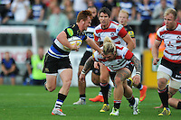 Rory Jennings of Bath Rugby fends Richard Hibbard of Gloucester Rugby. West Country Challenge Cup match, between Gloucester Rugby and Bath Rugby on September 13, 2015 at the Memorial Stadium in Bristol, England. Photo by: Patrick Khachfe / Onside Images