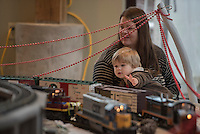 NWA Democrat-Gazette/J.T. WAMPLER Johnny Riley, 2, waves Sunday Nov. 19, 2015 at model trains while he and his mother Kelly Riley of Fayetteville visit the Botanical Garden of the Ozarks' Gardenland Express. The trains are set up by the Northwest Arkansas Garden Railway Society inside the main building at the Botanical Garden of the Ozarks in Fayetteville. The Gardenland Express continues from 1-4 p.m. Dec. 5, 6, 12 and 13. Admission for adults $5; children 5-12 $3; under 5 free.