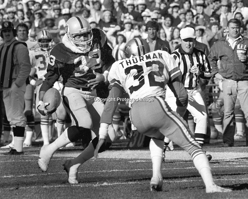 Raiders Kenny King running against the Dallas Cowboys Thurman defends..(1980 photo/Ron Riesterer)