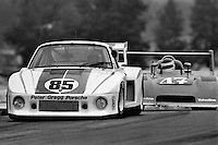 LEXINGTON, OH - AUGUST 26: The Porsche 935/Gp5 driven by Peter Gregg and Hurley Haywood runs ahead of eventual winner Bobby Rahal, driving a Ralt, during the Lumbermens 500 North American Sports Car Championship at the Mid-Ohio Sports Car Course near Lexington, Ohio, on August 26, 1979.