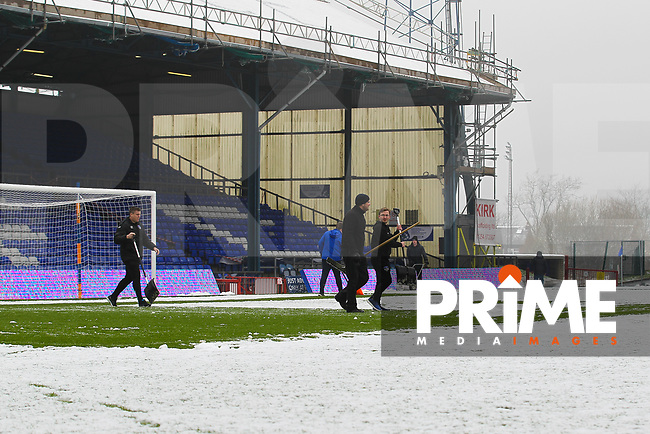 Groundmans clears the pitch full of snow ahead of the Sky Bet League 1 match between Oldham Athletic and Northampton Town at Boundary Park, Oldham, England on 9 December 2017. Photo by Juel Miah / PRiME Media Images.