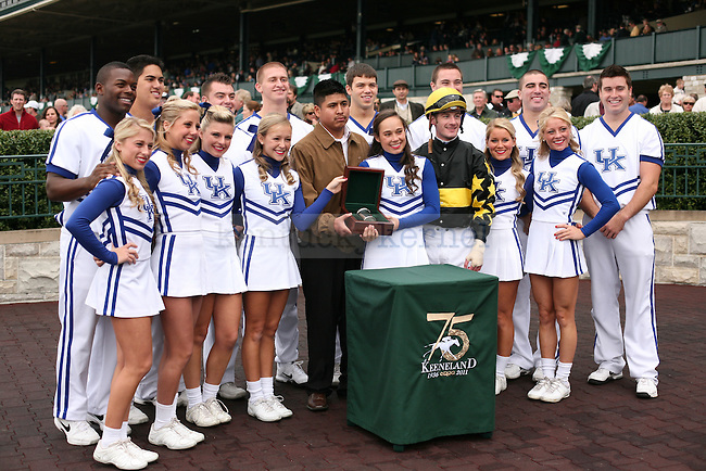 UK Cheerleaders present the winning trophy to jockey Julien Leparoux for the third race at Keeneland Racetrack in Lexington, Ky., on Friday, Oct. 21, 2011. Photo by Tessa Lighty | Staff