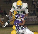 Gary Wilcox/Staff...10/10/08--Fletcher High player Mitchell Hester (#25) tries to break the tackle of Ed White player to add yards during the Ed White at Fletcher High  football game  Friday night at Fletcher High School in Jacksonville Beach. Fletcher won 41 to 38.