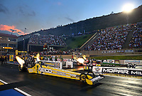 Jul. 19, 2013; Morrison, CO, USA: NHRA top fuel dragster driver Morgan Lucas (near lane) races alongside Terry McMillen during qualifying for the Mile High Nationals at Bandimere Speedway. Mandatory Credit: Mark J. Rebilas-