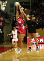 World goalshoot Catherine Latu takes a pass under pressure from Casey Williams during the International  Netball Series match between the NZ Silver Ferns and World 7 at TSB Bank Arena, Wellington, New Zealand on Monday, 24 August 2009. Photo: Dave Lintott / lintottphoto.co.nz