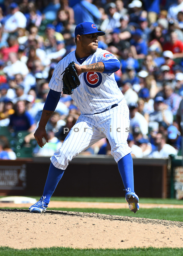 CHICAGO IL - May 18, 2017: Hector Rondon #56 of the Chicago Cubs during a game against the Cincinnati Reds on May 18, 2017 at Wrigley Field in Chicago, IL. The Cubs beat the Reds 9-5.(David Durochik/ SportPics)