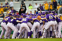 LSU Tigers team huddle before the game against the Auburn Tigers on March 23, 2013 at Alex Box Stadium in Baton Rouge, Louisiana. LSU defeated Auburn 5-1. (Andrew Woolley/Four Seam Images).