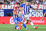 Atletico de Madrid's Yannick Ferreira Carrasco and Deportivo Alaves's Diego Torres during the match of La Liga Santander between Atletico de Madrid and Deportivo Alaves at Vicente Calderon Stadium. August 21, 2016. (ALTERPHOTOS/Rodrigo Jimenez)