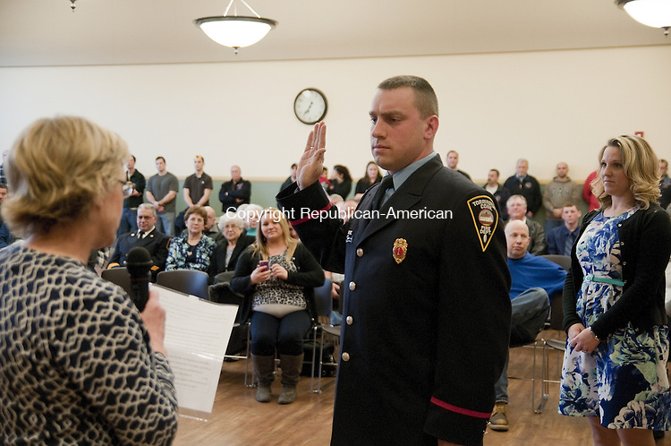 TORRINGTON, CT, 01 APRIL 15 - Torrington Fire Lt. Robert Shopey III is sworn in to his new rank Wednesday by Mayor Elinor C. Carbone as his wife Sarah looks on during a Board of Public Safety meeting.      Alec Johnson/ Republican-American