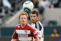 FC Dallas midfielder Dax McCarty (red) and Dema Kovalenko (w) of the LA Galaxy ball watching. The LA Galaxy defeated FC Dallas 2-1 at Home Depot Center stadium in Carson, California on Sunday October 24, 2010.