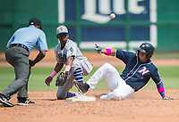 NWA Democrat-Gazette/CHARLIE KAIJO Northwest Arkansas Naturals left fielder Anderson Miller (6) slides to second during a baseball game, Sunday, May 13, 2018 at Arvest Ballpark in Springdale.