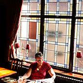 """London, Great Britain, April 2010:.Woman reading newspaper at """"The Globe"""" pub on Baker street..(Photo by Piotr Malecki / Napo Images)..Londyn, Wielka Brytania, Kwiecien 2010:.Kobieta w czyta gazete w pubie """"The Globe"""" na Baker street.. Fot: Piotr Malecki / Napo Images"""