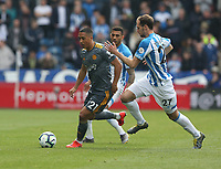 Leicester City's Youri Tielemans is chased by Huddersfield Town's Jon Gorenc Stankovic <br /> <br /> Photographer Stephen White/CameraSport<br /> <br /> The Premier League - Huddersfield Town v Leicester City - Saturday 6th April 2019 - John Smith's Stadium - Huddersfield<br /> <br /> World Copyright © 2019 CameraSport. All rights reserved. 43 Linden Ave. Countesthorpe. Leicester. England. LE8 5PG - Tel: +44 (0) 116 277 4147 - admin@camerasport.com - www.camerasport.com