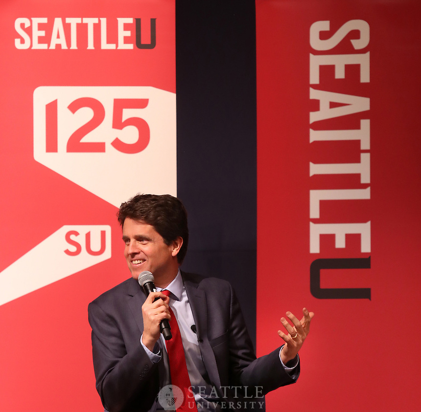 """December 7th 2016- Mark Shriver, president of Save the Children's Action Network in Washington D.C. talks with Enrique Cerna, KCTS9, director of partnerships about Shriver's new book """"Pilgrimage: My Search for The Real Pope Francis"""" during a Seattle University 125th Anniversary lecture in Pigott."""