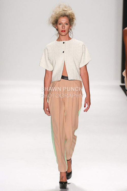 Model walks runway in an outfit from the Altaf Maaneshia Spring Summer 2015 collection, during the Art Hearts Fashion Spring 2015 fashion show, during Mercedes-Benz Fashion Week Spring 2015 in New York City.