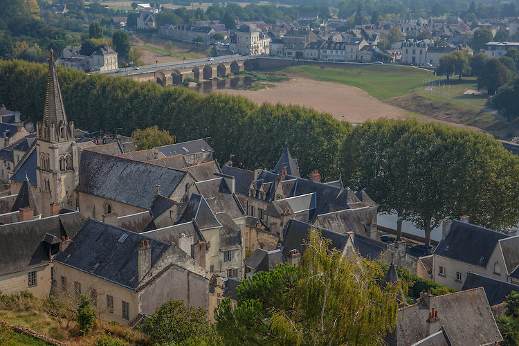 The cobbled streets in the old town section of Chinon wind past intimate restaurants, stone buildings, & floral displays.