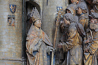 The arrival of St Firmin in Amiens, welcomed by senator Faustinien, Gothic style polychrome high-relief sculpture from the South side of the choir screen, 1490-1530, commissioned by canon Adrien de Henencourt, depicting the life of St Firmin, at the Basilique Cathedrale Notre-Dame d'Amiens or Cathedral Basilica of Our Lady of Amiens, built 1220-70 in Gothic style, Amiens, Picardy, France. St Firmin, 272-303 AD, was the first bishop of Amiens. Amiens Cathedral was listed as a UNESCO World Heritage Site in 1981. Picture by Manuel Cohen