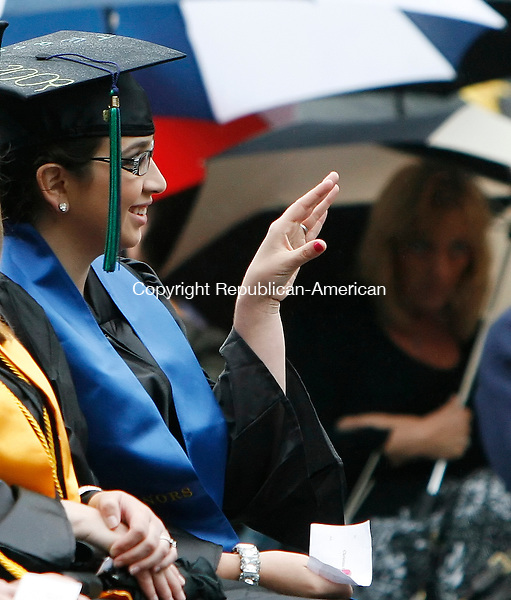 WATERBURY, CT 05/28/09- 052809BZ07- Christina Quiles, of Waterbury, waves to family and friends during Naugatuck Valley Community College commencement excercies Thursday night.<br /> Jamison C. Bazinet Republican-American