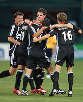 DC United midfielder Christian Gomez (10) celebrates with team mates after he scores in the 7th minute of play. Monarcas Morelia tied DC United 1-1 in  the SuperLiga opening match of the group B, at RFK Stadium Washington DC, Wednesday July 26, 2007.
