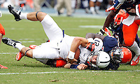 Penn State quarterback Steven Bench (12) is tackled by Virginia linebacker LaRoy Reynolds (9) during the first half of an NCAA football game Saturday Sept. 8, 2012 in Charlottesville, VA. Photo/Andrew Shurtleff