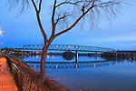 The Marietta Williamstown Bridge over the Ohio River at Marietta Ohio after sunset, Seen from The Ohio Riverfront Park, USA