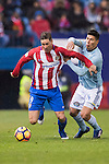 Fernando Torres (l) of Atletico de Madrid fights for the ball with Facundo Roncaglia of RC Celta de Vigo during their La Liga match between Atletico de Madrid and RC Celta de Vigo at the Vicente Calderón Stadium on 12 February 2017 in Madrid, Spain. Photo by Diego Gonzalez Souto / Power Sport Images