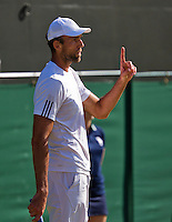 England, London, Juli 04, 2015, Tennis, Wimbledon, Ivo Karlovic (CRO) asking for a hawkeye in his match against Jo-Wilfried Tsonga (FRA)<br /> Photo: Tennisimages/Henk Koster