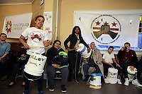 (171126RREI2157) Anna on drum. Many Languages One Voice,  MLOV,  Holiday Celebration and Immigrant Legal Rights Workshop in La Casa, Mt. Pleasant. MLOV is on the same block as La Esquina where Latinos have gathered for decades at the corner of Mt. Pleasant St. and Kenyon St. NW. to play chekers (damas). Washington DC.  Nov. 26 ,2017 . ©  Rick Reinhard  2017     email   rick@rickreinhard.com